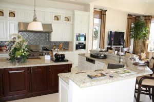 "Kitchen has maple cabinetry; perimeter cabinetry  painted in ""frost white"", Island cabinetry stained in ""buffalo""."
